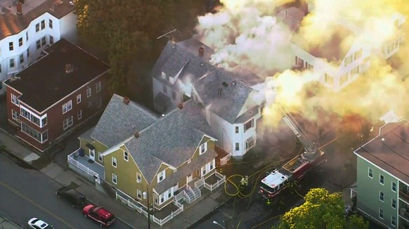 In this image take from video provided by WCVB in Boston, firefighters battle a large structure fire in Lawrence, Mass, a suburb of Boston, Thursday, Sept. 13, 2018. Emergency crews are responding to what they believe is a series of gas explosions that have damaged homes across three communities north of Boston. (WCVB via AP)