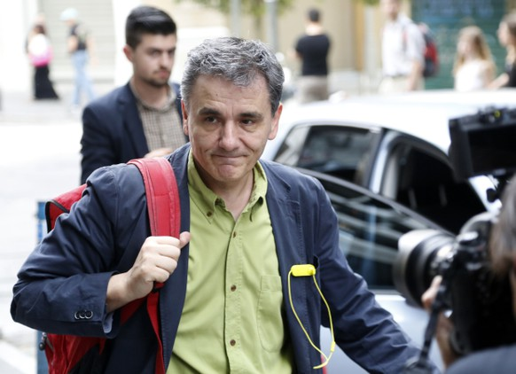 FILE - This is a Sunday, June 28, 2015 file photo of Greece's Deputy Foreign Minister for international economic relations, Euclid Tsakalotos, as arrives at the Finance Ministry in Athens. Following Sunday's referendum the Greek government named lead bailout negotiator Euclid Tsakalotos as  the new finance minister Monday July 6, 2015. (AP Photo/Petros Karadjias, File)