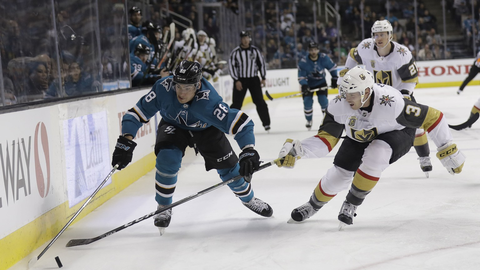 San Jose Sharks' Timo Meier, left, is defended by Vegas Golden Knights' Brayden McNabb during the second period of an NHL hockey game Thursday, March 22, 2018, in San Jose, Calif. (AP Photo/Marcio Jose Sanchez)