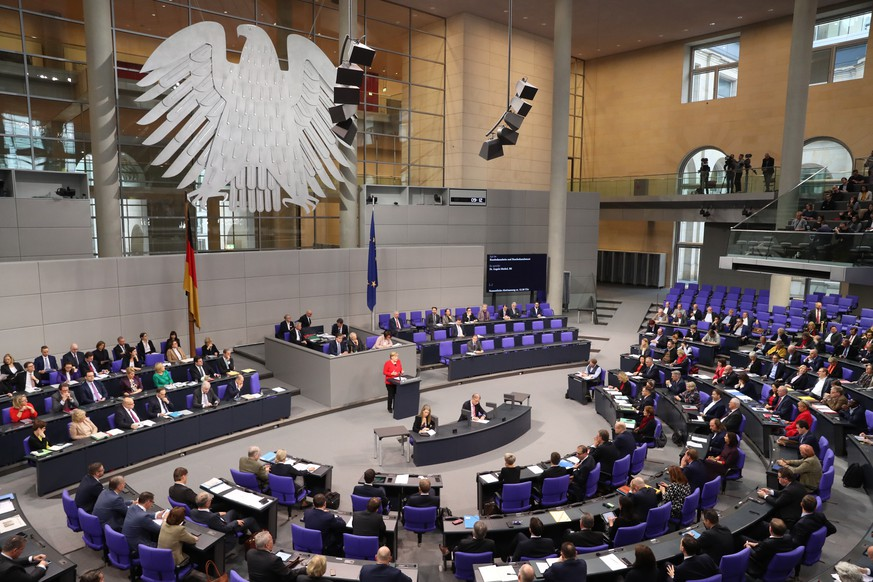 epa08028266 German Chancellor Angela Merkel speaks during a session of the 'Bundestag' German parliament in Berlin, Germany, 27 November 2019. Members of Bundestag will gather to debate on government policy.  EPA/HAYOUNG JEON