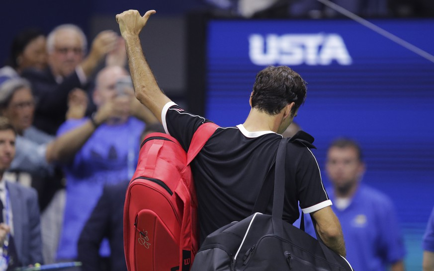 Roger Federer, of Switzerland, flashes a thumbs-up to the crowd after a loss to Grigor Dimitrov, of Bulgaria, during the quarterfinals of the U.S. Open tennis tournament Tuesday, Sept. 3, 2019, in New York. Dimitrov won 3-6, 6-4, 6-3, 6-4, 6-2. (AP Photo/Charles Krupa) Roger Federer