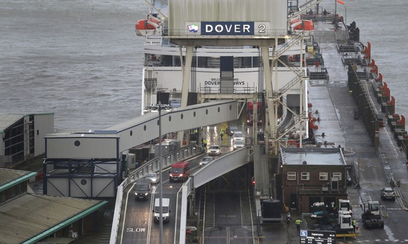 Lorries arrive onboard the DFDS Dover Seaways ferry at the Port of Dover on the first fully operational day at the port under post-Brexit regulations, in Kent, England, Monday, Jan. 4, 2021. (Gareth Fuller/PA via AP)