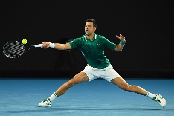 epa09015753 Novak Djokovic of Serbia in action during his Men's Quarter finals singles match against Alexander Zverev of Germany on Day 9 of the Australian Open at Melbourne Park in Melbourne, Australia, 16 February 2021.  EPA/DAVE HUNT AUSTRALIA AND NEW ZEALAND OUT