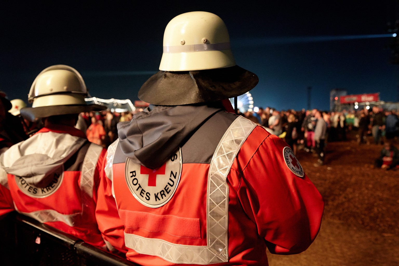 epa05345146 Members of the Deutsches Rotes Kreuz (German Red Cross) are on stand-by during the festival 'Rock am Ring' in Mendig, Germany, 03 June 2016. The event originally took place at the Nuerburgring circuit before it closed its doors in 2014. The 31th edition of the festival takes place on a former military airfield in Mendig from 03 to 05 June.  EPA/THOMAS FREY
