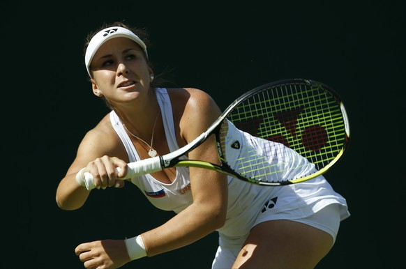 Belinda Bencic of Switzerland returns a ball to Tsvetana Pironkova of Bulgaria during the women's singles first round match at the All England Lawn Tennis Championships in Wimbledon, London, Monday June 29, 2015. (AP Photo/Alastair Grant)