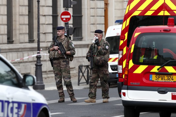 epa07891619 Military forces establish a security perimeter near Paris police headquarters after a man has been killed after attacking officers with a knife in Paris, France, 03 October 2019. According to reports, a man was killed after attacking officers with a knife. Two officers were injured in the incident.  EPA/IAN LANGSDON