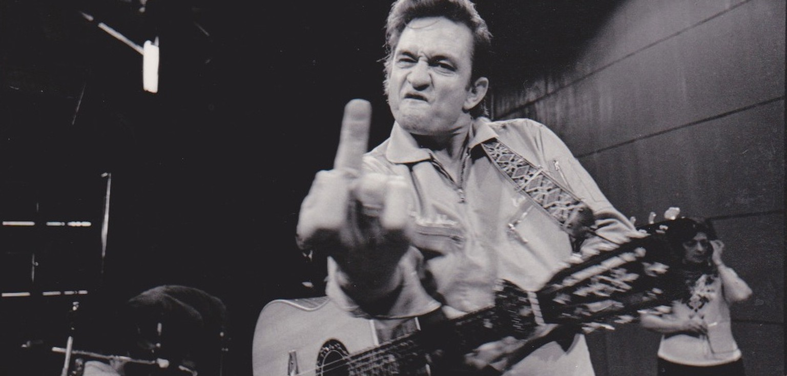 johnny cash san quentin http://recordmecca.com/item-archives/johnny-cash-original-jim-marshall-giving-the-finger-san-quentin-photograph/