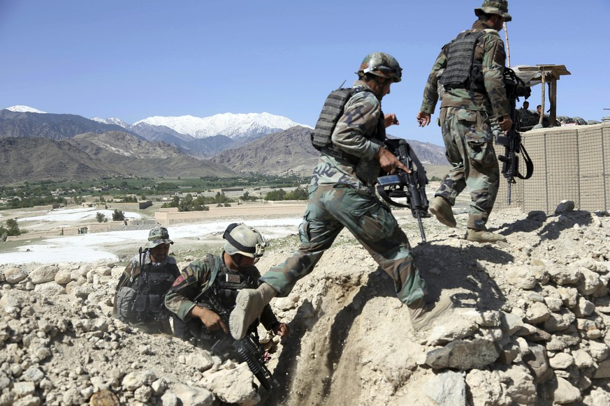 Afghan commandos patrol Pandola village near the site of a U.S. bombing in the Achin district of Jalalabad, east of Kabul, Afghanistan, Friday, April 14, 2017. U.S. forces in Afghanistan on Thursday struck an Islamic State tunnel complex in eastern Afghanistan with the largest non-nuclear weapon every used in combat by the U.S. military, Pentagon officials said. (AP Photo/Rahmat Gul)