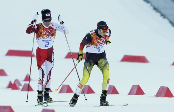 Japan's Akito Watabe, left, and Germany's Eric Frenzel ski during the cross-country portion of the Nordic combined at the 2014 Winter Olympics, Wednesday, Feb. 12, 2014, in Krasnaya Polyana, Russia. (AP Photo/Matthias Schrader)