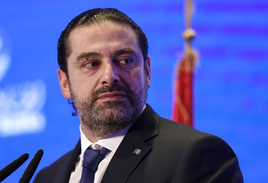FILE - In this Nov. 23, 2017 file photo, Lebanese Prime Minister Saad Hariri speaks during a regional banking conference, in Beirut, Lebanon. Hariri formally rescinded his resignation following a consensus deal reached with rival political parties. The Tuesday, Dec. 5, 2017,  announcement came at the end of the first cabinet meeting to be held since Lebanon was thrown into a political crisis following Hariri's Nov. 4 surprise resignation from Saudi Arabia. (AP Photo/Hussein Malla, File)