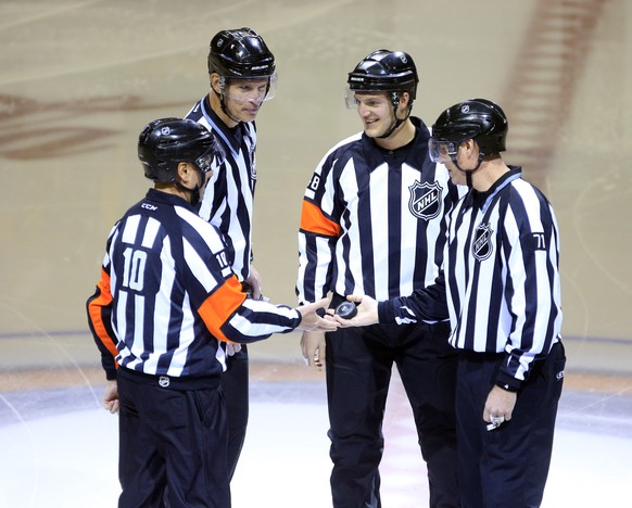 Referee Garrett Rank (48) is greeted prior to the opening faceoff between the Buffalo Sabres and the Minnesota Wild by fellow referee Paul Devorski (10), linesman Brian Murphy (93) and Brad Kovachik (71) as Rank was refereeing his first NHL hockey game  on Thursday, Jan. 15, 2015, in Buffalo, N.Y.  (AP Photo/The Buffalo News,  Harry Scull Jr.)  TV OUT; MAGAZINES OUT; MANDATORY CREDIT; BATAVIA DAILY NEWS OUT; DUNKIRK OBSERVER OUT; JAMESTOWN POST-JOURNAL OUT; LOCKPORT UNION-SUN JOURNAL OUT; NIAGARA GAZETTE OUT; OLEAN TIMES-HERALD OUT; SALAMANCA PRESS OUT; TONAWANDA NEWS OUT