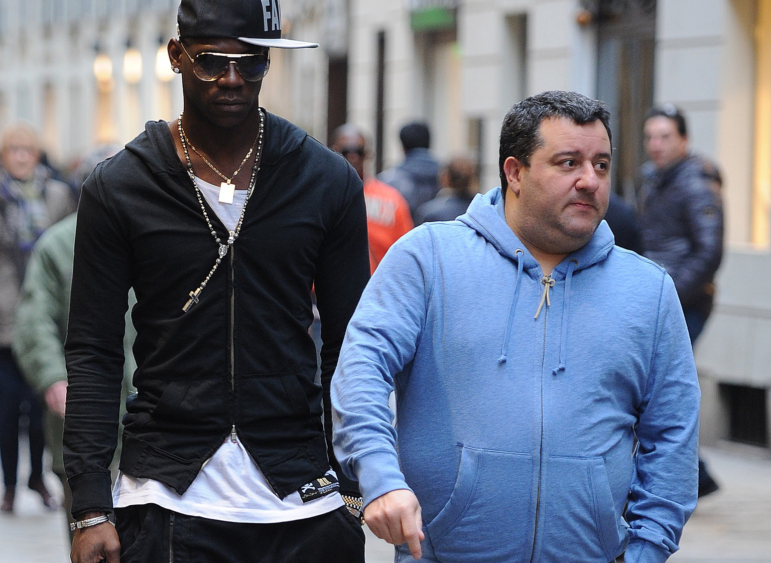 MILAN, ITALY - MARCH 05:  Agent Mino Raiola and Mario balotelli are seen on March 5, 2013 in Milan, Italy.  (Photo by Jacopo Raule/Getty Images)