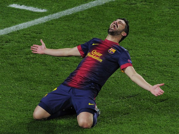(FILES) Barcelona's forward David Villa celebrates after scoring against Real Sociedad during their Spanish League football match at Camp Nou stadium in Barcelona on December 12, 2010. Spain's top scorer David Villa said he will retire from international duty after the World Cup in Brazil, in an interview broadcast on June 4, 2014. AFP PHOTO/LLUIS GENE