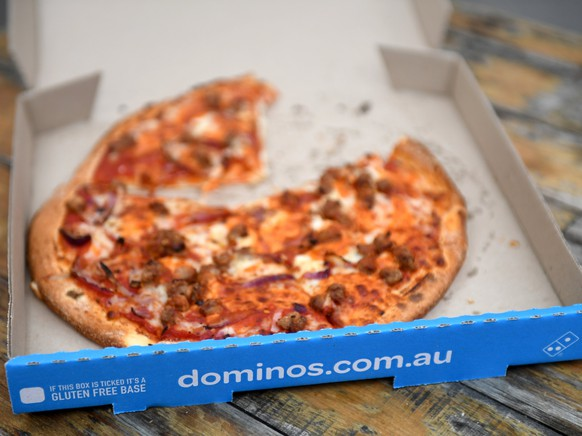 epa06146566 A pizza is seen at a Domino's Pizza store in Sydney, New South Wales, Australia, 15 August 2017. Shares in Domino's Pizza have fallen sharply after the fast food retailer's strong profit and sales growth missed its own forecasts and announced a 300 million Australian dollar (235 million US dollar) share buyback after its shares have slipped about 22 percent in the past eight months.  EPA/PAUL MILLER  AUSTRALIA AND NEW ZEALAND OUT