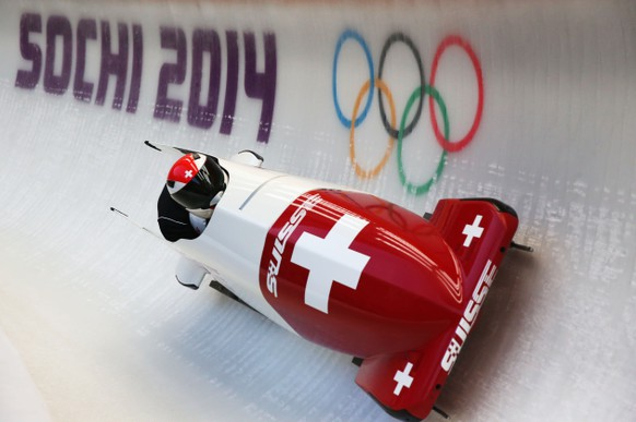SOCHI, RUSSIA - FEBRUARY 13:  Beat Hefti of Switzerland pilots a run during a Men's Two-man Bobsleigh training session on day 6 of the Sochi 2014 Winter Olympics at the Sanki Sliding Center on February 13, 2014 in Sochi, Russia.  (Photo by Alex Livesey/Getty Images)