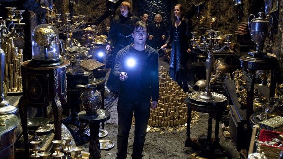 "DANIEL RADCLIFFE (foreground) as Harry Potter and (background l-r) RUPERT GRINT as Ron Weasley, WARWICK DAVIS as Griphook, JON KEY as Bogrod and EMMA WATSON as Hermione Granger and in Warner Bros. Pictures' fantasy adventure ""HARRY POTTER AND THE DEATHLY HALLOWS – PART 2,"" a Warner Bros. Pictures release."