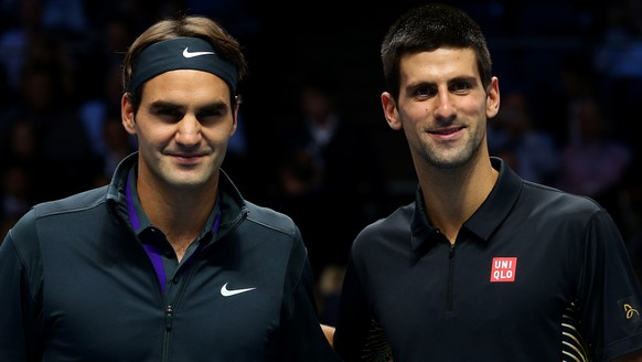 LONDON, ENGLAND - NOVEMBER 12:  Roger Federer of Switzerland poses next to  Novak Djokovic of Serbia before their men's singles final match during day eight of the ATP World Tour Finals at O2 Arena on November 12, 2012 in London, England.  (Photo by Julian Finney/Getty Images)