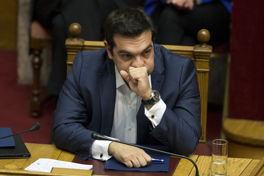 Greek Prime Minister Alexis Tsipras, gestures during a parliamentary session before the confidence vote, in Athens, on Wednesday, Oct. 7, 2015. (AP Photo/Petros Giannakouris)