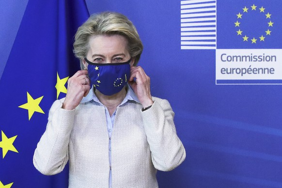 European Commission President Ursula von der Leyen removes her protective face mask prior to meeting with Jordan's King Abdullah II at EU headquarters in Brussels, Wednesday, May 5, 2021. (Yves Herman, Pool via AP)