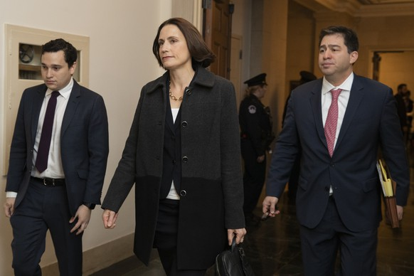 Former White House national security aide Fiona Hill, center, arrives to testify before the House Intelligence Committee on Capitol Hill in Washington, Thursday, Nov. 21, 2019, during a public impeachment hearing of President Donald Trump's efforts to tie U.S. aid for Ukraine to investigations of his political opponents. (AP Photo/Manuel Balce Ceneta) Fiona Hill