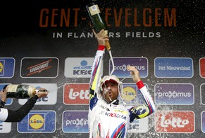 Katusha team rider Lucas Paolini of Italy celebrates on the podium after winning the Gent-Wevelgem classic cycling race in Wevelgem March 29, 2015. Italian veteran Paolini outwitted a select group of favourites to win the Gent-Wevelgem one-day classic in difficult conditions on Sunday.   REUTERS/Francois Lenoir