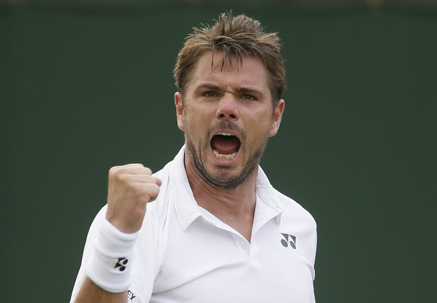 Stan Wawrinka of Switzerland celebrates breaking the serve of Thomas Fabbiano of Italy during their men's singles match on the third day at the Wimbledon Tennis Championships in London, Wednesday July 4, 2018. (AP Photo/Tim Ireland)