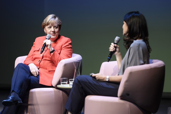 epa06051631 German Chancellor Angela Merkel (L) talks with the Chief Editor of Brigitte Magazine, Brigitte Huber (R) during the 'Brigitte talking' event in Berlin, Germany, 26 June 2017. Merkel attended the Brigitte live talk to speak about the upcoming election battle.  EPA/CLEMENS BILAN