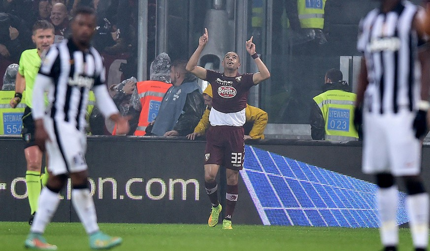 epa04509931 Torino's defender Bruno Peres celebrates after scoring  during the Italian Serie A soccer match between Juventus FC and Torino FC at Juventus Stadium in Turin, Italy, 30 November 2014.  EPA/ALESSANDRO DI MARCO