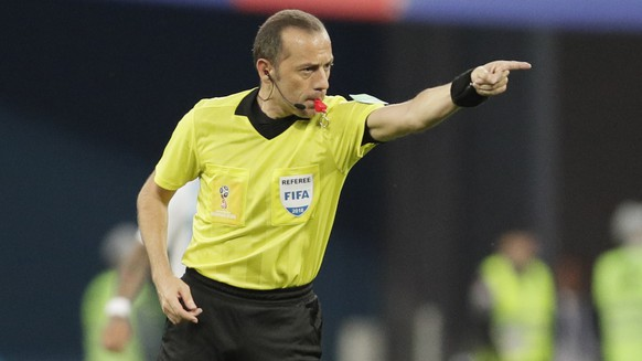 Referee Cuneyt Cakir from Turkey gestures during the group D match between Argentina and Nigeria at the 2018 soccer World Cup in the St. Petersburg Stadium in St. Petersburg, Russia, Tuesday, June 26, 2018. (AP Photo/Dmitri Lovetsky)