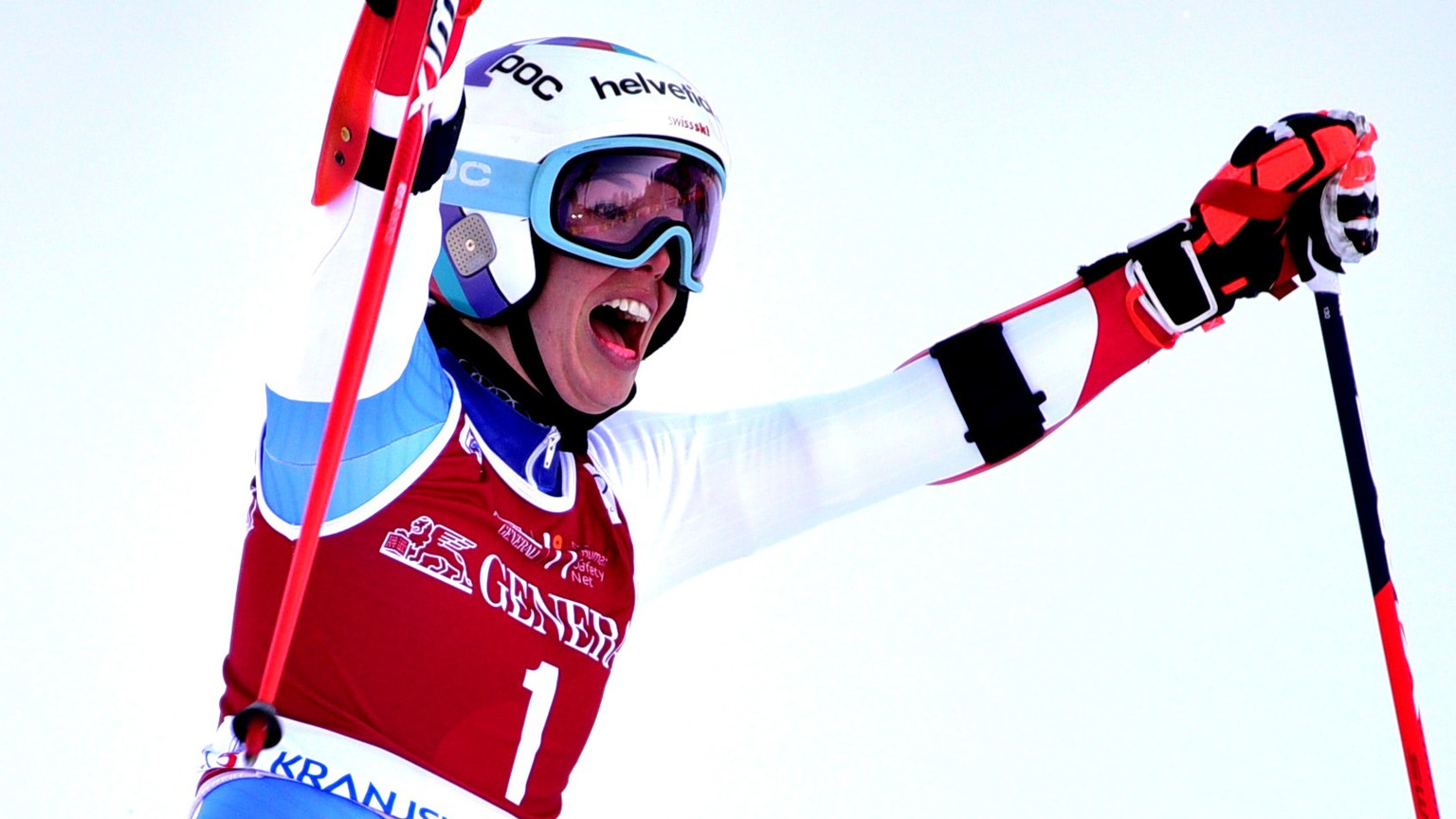 epa08941688 Michelle Gisin of Switzerland celebrates after taking the third place in the women's Giant Slalom race of the FIS Alpine Skiing World Cup in Kranjska Gora, Slovenia, 16 January 2021.  EPA/IGOR KUPLJENIK