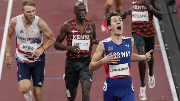 Jakob Ingebrigtsen, of Norway celebrates winning the gold medal in the final of the men's 1,500-meters at the 2020 Summer Olympics, Saturday, Aug. 7, 2021, in Tokyo, Japan. (AP Photo/Francisco Seco)