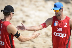 Swiss Sebastien Chevallier, right, and Alexei Strasser, left, celebrate after winning the final for the third place between Swiss Sebastien Chevallier and Alexei Strasser and Italy's Matteo Cecchini and Matteo Martino at the Satellite CEV Beach Volley tournament, in Lausanne, Switzerland, Sunday, June 29, 2014. The Swiss team won the game and takes the third place. (KEYSTONE/Laurent Gillieron)