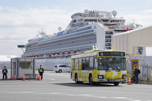 epa08229535 (FILE) - A bus carrying passengers of the Diamond Princess cruise ship, leaves the Daikoku Pier Cruise Terminal in Yokohama, Japan, 19 February 2020. (reissued 20 February 2020). According to local media reports two elderly passengers from the Diamond Princess have died.  EPA/TORU HANAI