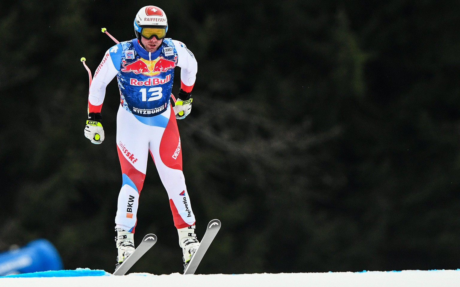 epa06443111 Beat Feuz of Switzerland takes a jump during the first training run for the Men's Downhill race of the FIS Alpine Skiing World Cup event in Kitzbuehel, Austria, 16 January 2018.  EPA/CHRISTIAN BRUNA