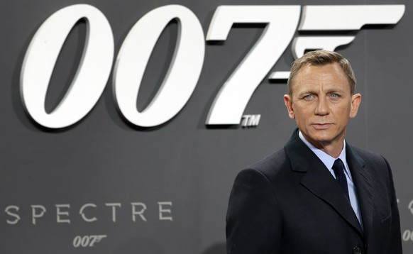 FILE - This is a Wednesday, Oct. 28, 2015 file photo of actor Daniel Craig poses for the media as he arrives for the German premiere of the James Bond movie