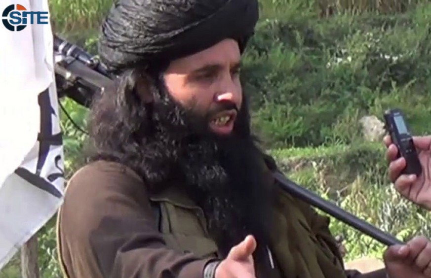 This undated image provided the SITE Intel Group, an American private terrorist threat analysis company, on Friday, Nov. 8, 2013, and authenticated based on details in it, shows Mullah Fazlullah in Pakistan. Fazlullah, the ruthless commander behind the attack on teenage activist Malala Yousafzai as well as a series of bombings and beheadings, was chosen Thursday as the leader of the Pakistani Taliban, nearly a week after a U.S. drone strike killed the previous chief. (AP Photo/SITE Intel Group)