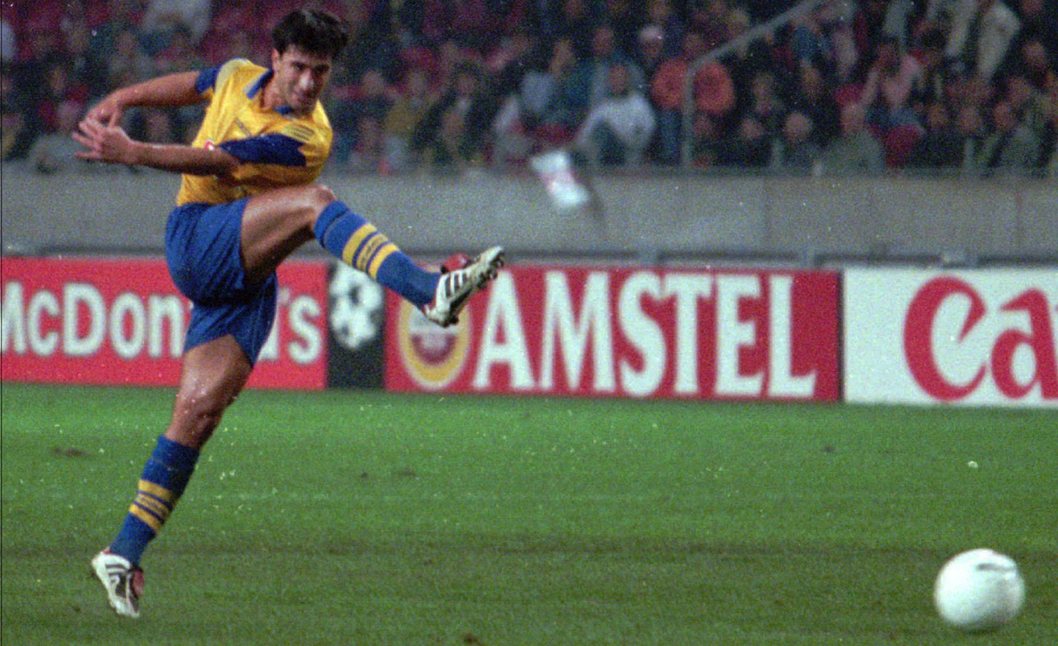 Grasshoppers Murat Yakin scores decisive goal against Ajax during a Champions League match in Amsterdam, Wednesday Sept. 25 1996. Grasshoppers won 1-0.(AP Photo/Dusan Vranic)