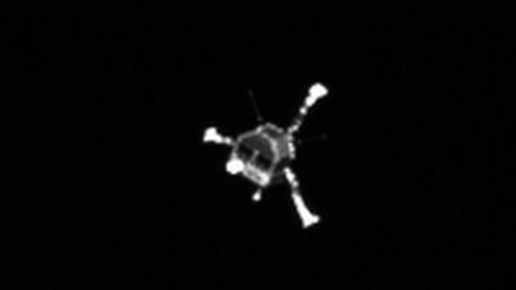 epa04798755 (FILE) A file handout picture ptovided by the European Space Agency (ESA) and dated 12 November 2014 shows the Philae lander shortly after separation from the Rosetta orbiter. According to a statement by ESA on 14 June 2015, comet lander Philae has sent its first signals to the ESA operations center in Darmstadt, Germany, late 13 June after 310 days of hibernation. The lander had been shut down since 15 November after spending some 60 hours on Comet 67P/Churyumov-Gerasimenko.  EPA/ESA/ROSETTA/MPS FOR OSIRIS/MPS/UPD/LAM/IAA/SSO/INTA/UPM/DASP/IDA MANDATORY CREDIT HANDOUT EDITORIAL USE ONLY/NO SALES *** Local Caption *** 51660141