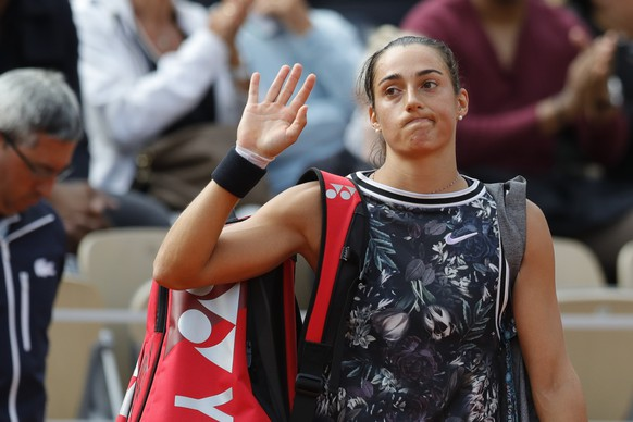 France's Caroline Garcia waves goodbye after losing her second round match of the French Open tennis tournament against Russia's Anna Blinkova at the Roland Garros stadium in Paris, Thursday, May 30, 2019. (AP Photo/Pavel Golovkin)