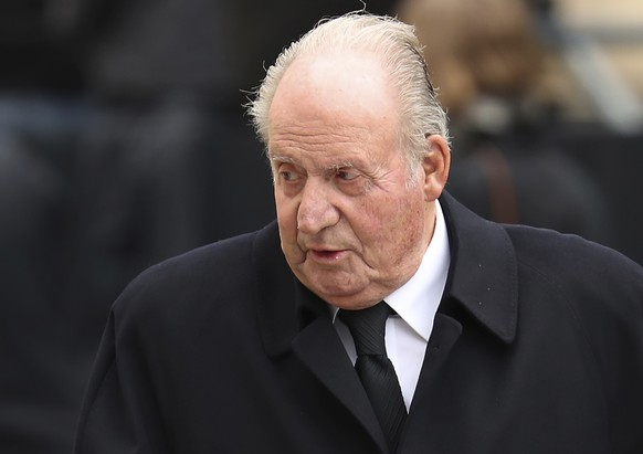 FILE - In this Saturday, May 4, 2019 file photo, Spain's former King Juan Carlos, leaves the Notre Dame cathedral after attending at the funeral of the Grand Duke Jean of Luxembourg, in Luxembourg.  The law firm representing Juan Carlos I said Wednesday Dec. 9, 2020, that the former monarch has paid off a debt of nearly 680,000 euros (dollars 821,000) following a voluntary declaration of previously undisclosed income to Spain