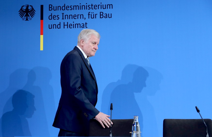 epa07748572 Minister of Interior, Construction and Homeland Horst Seehofer during a press conference reporting on the incident at the Frankfurt main station, in Berlin, Germany, 30 July 2019. An eight-year-old boy and his 40-year-old mother were pushed onto the tracks while a high-speed train was arriving. The boy was hit by the train and died while his mother was able to escape.  EPA/HAYOUNG JEON