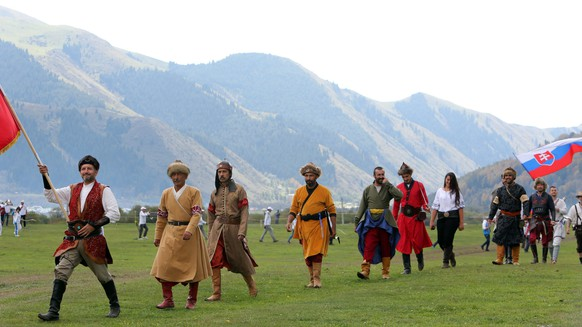 epa05525420 Participants parade during the 2nd World Nomad Games at Issyk-Kul lake in Cholpon-Ata, Kyrgyzstan, 05 September 2016. Teams from Azerbaijan, Kazakhstan, Mongolia, Kazakhstan and Tajikistan are competing in ethnic sport games during the cultural event that runs from 03 to 08 September. The mission of the games is to promote the revival and preservation of the historical heritage of the nomadic peoples of the world civilization.  EPA/IGOR KOVALENKO
