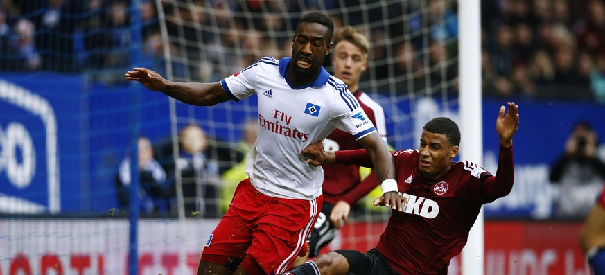 HAMBURG, GERMANY - MARCH 16:  Johan Djourou (L) of Hamburg and  Martin Angha (R) of Nuernberg compete for the ball during the Bundesliga match between Hamburger SV and 1. FC Nuernberg at Imtech Arena on March 16, 2014 in Hamburg, Germany.  (Photo by Oliver Hardt/Bongarts/Getty Images)