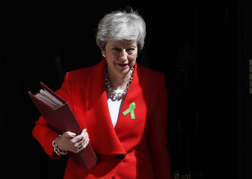 Britain's Prime Minister Theresa May leaves 10 Downing Street for her weekly Prime Minister's Questions in the House of Commons in London, Wednesday, May 15, 2019. (AP Photo/Alastair Grant)