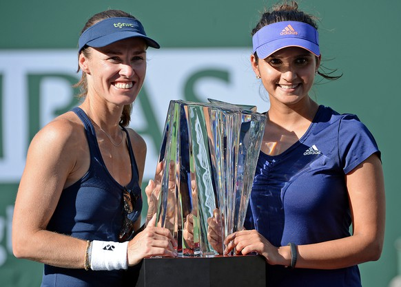 Mar 21, 2015; Indian Wells, CA, USA; Martina Hingis (SUI) and Sania Mirza (IND) with the championship trophy after winning their doubles final match against Ekaterina Makarova (RUS) and Elena Vesnina (RUS) in the BNP Paribas Open at the Indian Wells Tennis Garden. Hingis/Mirza won 6-3, 6-4. Mandatory Credit: Jayne Kamin-Oncea-USA TODAY Sports
