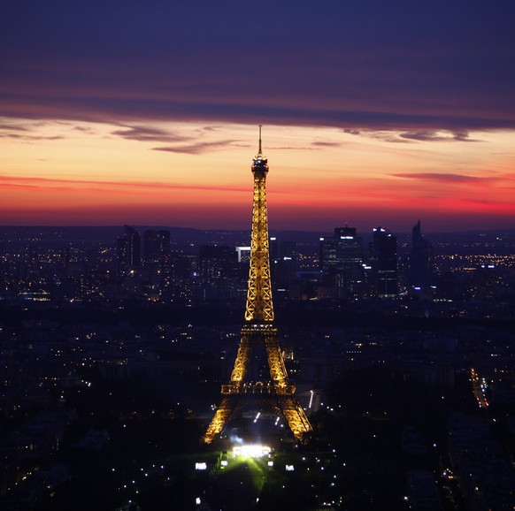 The illuminated Eiffel Tower is seen in Paris, Thursday July 14, 2011 at sunset.  (AP Photo/Thibault Camus)