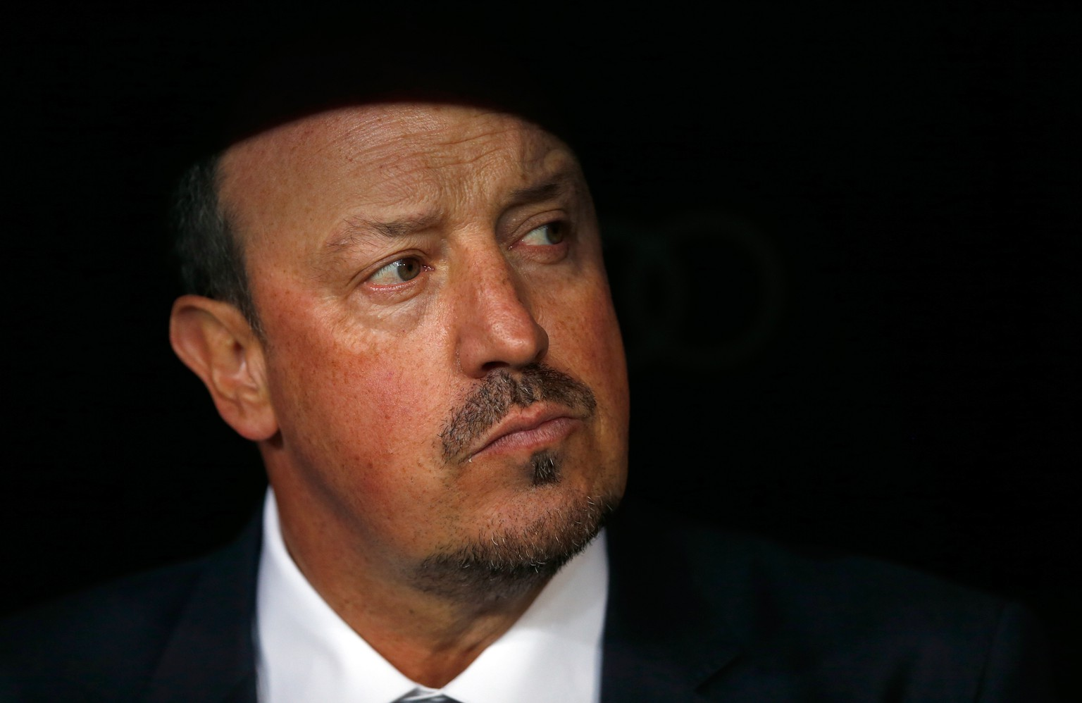Real Madrid's head coach Rafael Benitez waits for the start of the first clasico of the season between Real Madrid and Barcelona at the Santiago Bernabeu stadium in Madrid, Spain, Saturday, Nov. 21, 2015. (AP Photo/Daniel Ochoa de Olza)
