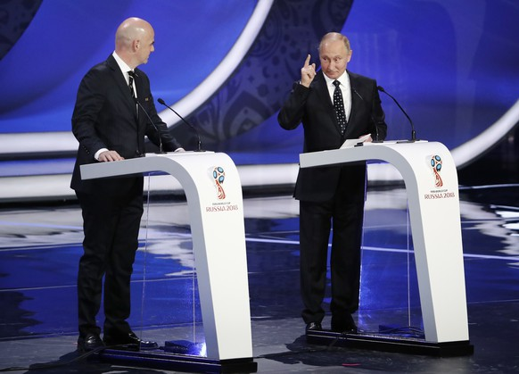 Russian President Vladimir Putin, right, is watched by FIFA president Gianni Infantino as he speaks before the 2018 soccer World Cup draw in the Kremlin in Moscow, Friday Dec. 1, 2017. (AP Photo/Pavel Golovkin)