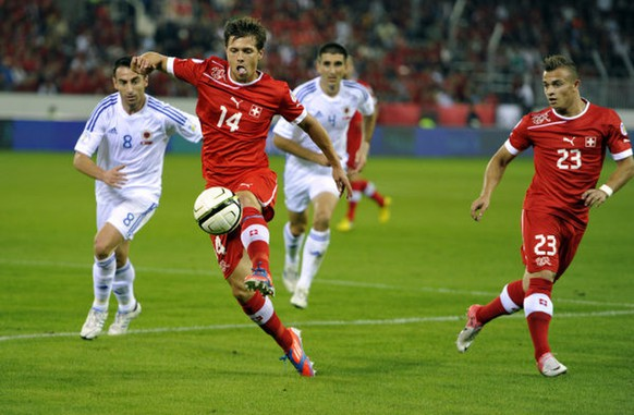 Switzerland`s Valentin Stocker, left and Xherdan Shaqiri fighting for the ball during the 2014 World Cup Brazil group E qualification soccer match between Switzerland and Albania at the Swisspor Arena in Lucerne, Switzerland, on Thuesday, September 11.2012. (KEYSTONE/Sigi Tischler)