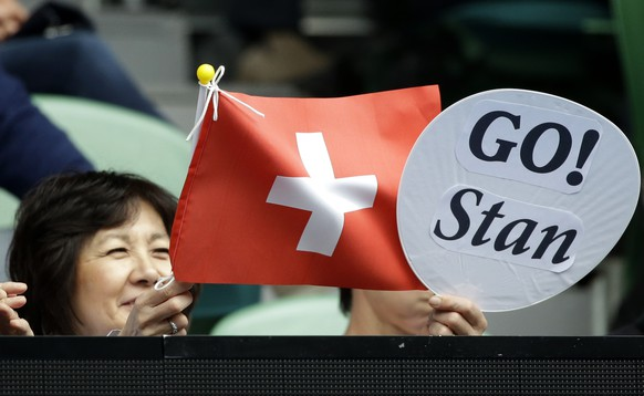 Fans support Switzerland's Stan Wawrinka playing Serbia's Viktor Troicki during their third round match at the Australian Open tennis championships in Melbourne, Australia, Friday, Jan. 20, 2017. (AP Photo/Dita Alangkara)